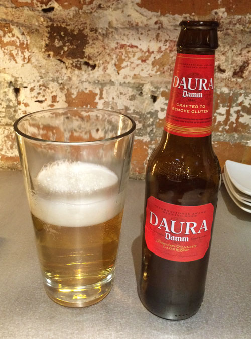 Glass and bottle of Estrella Damm Daura Gluten free beer