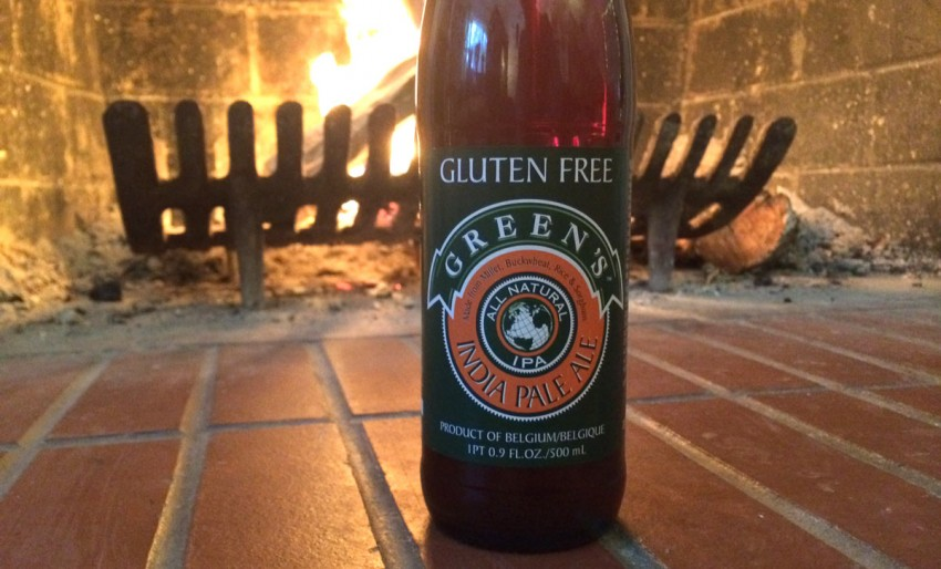 Bottle off Greens's IPA in front of a Fireplace