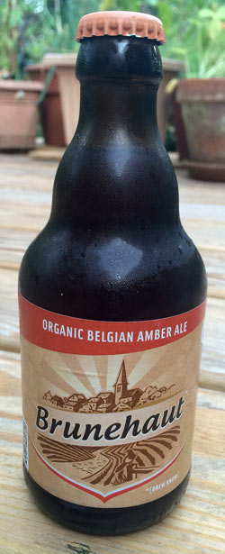 bottle of cold Brunehaut Belgian Organic Amber beer