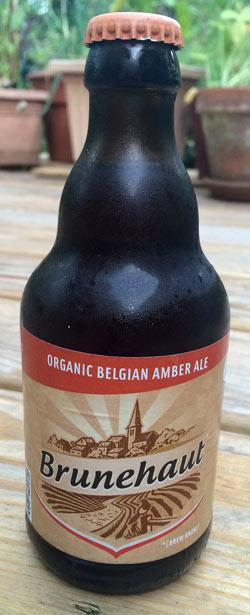 bottle of cold Brunehaut Belgian Organic Amber beer