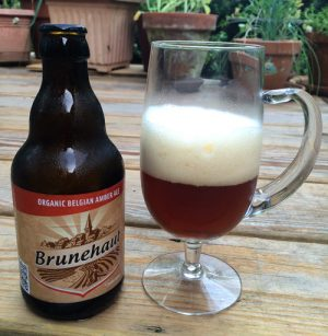 Bottle and glass of Brunehaut Belgian Organic Amber beer