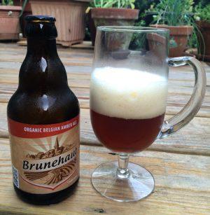 Bottle and glass of Brunehaut Belgian Organic Amber beer