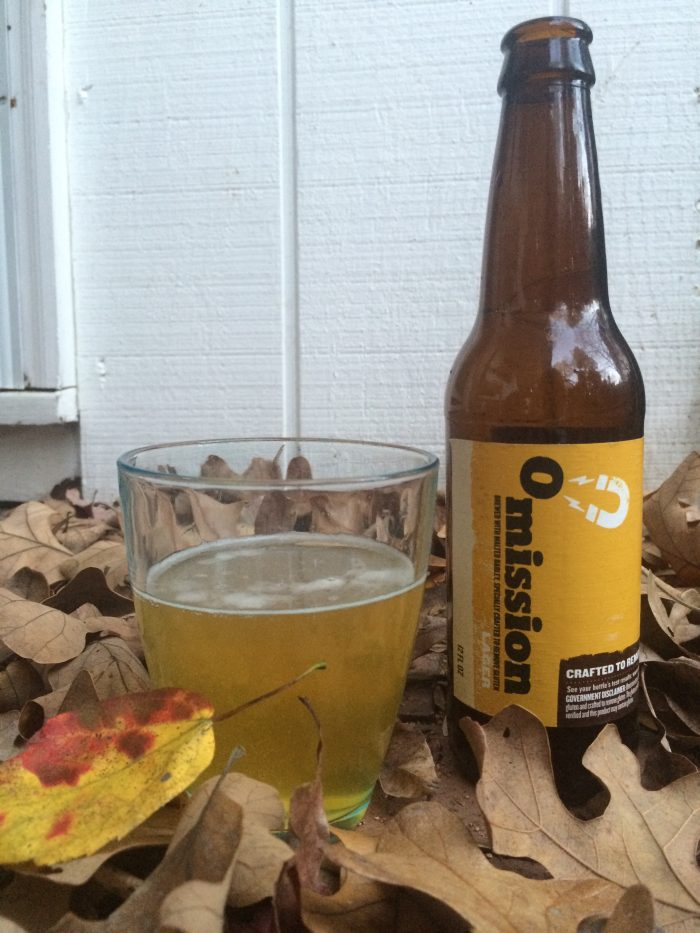 Omission Lager bottle and glass with fall leaves