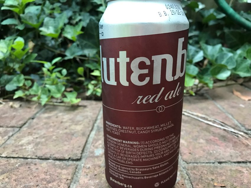 close up of Can of Glutenberg Red Ale- Gluten free Beer, on brick and Ivy background