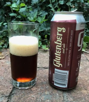 Pour of Glutenberg Red Ale gluten-free beer, in a glass with can