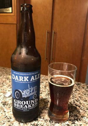 Glass and bottle of Ground Breaker Dark Ale gluten free beer