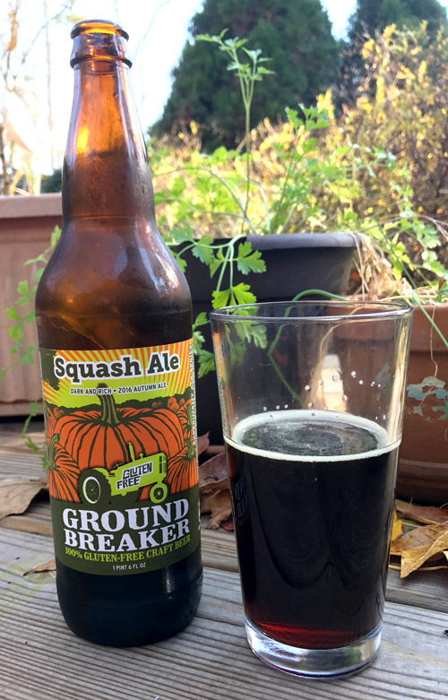 ground breaker squash ale dark beer in glass with bottle